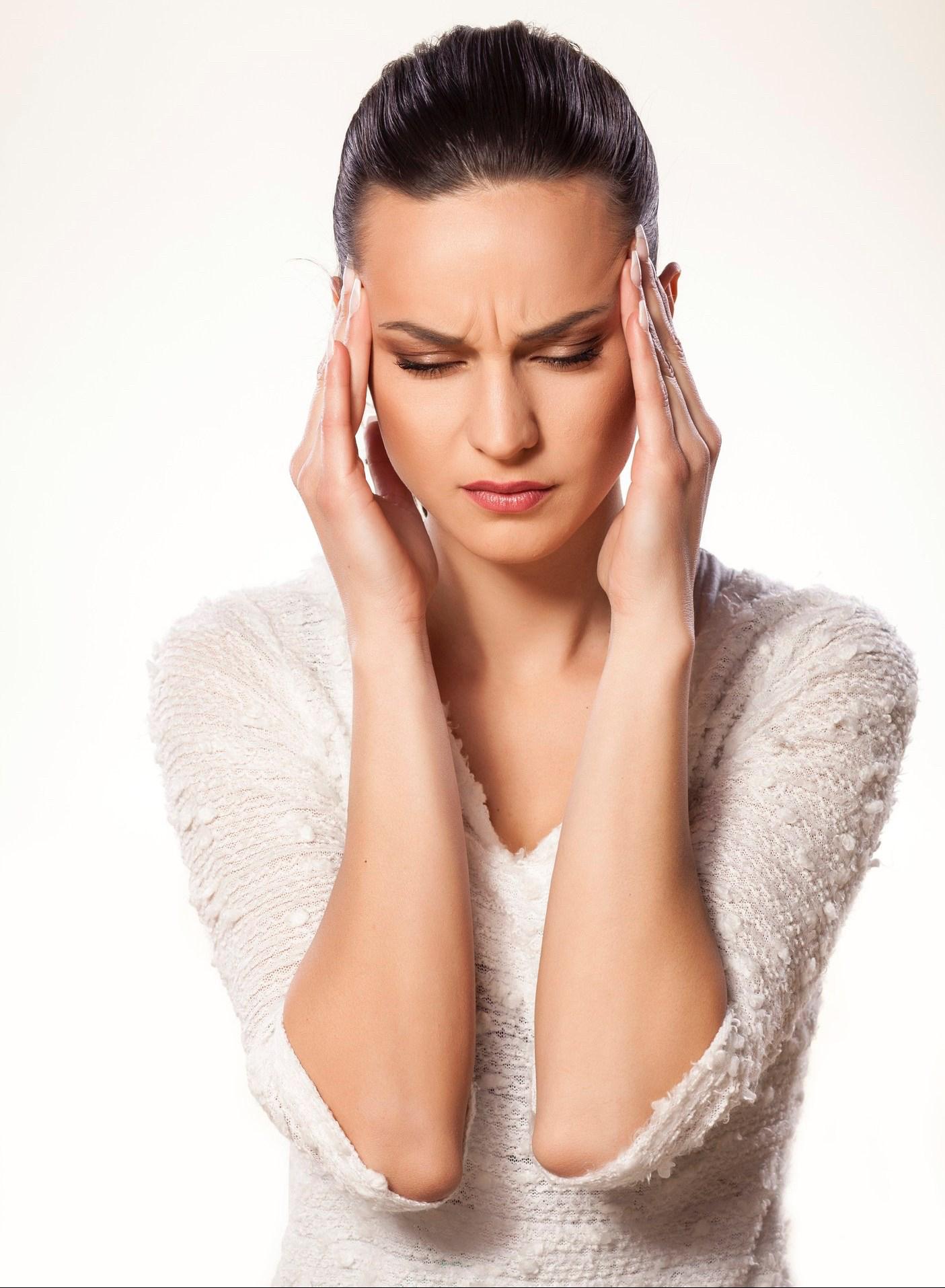 Woman with migraine image for acupuncture therapy in Edmonton for tension and migraine headaches.